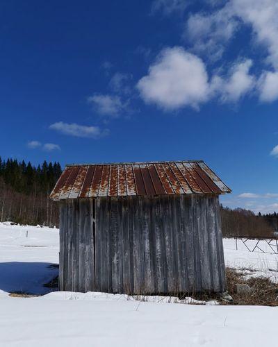 Weathered rusty barn on a beautiful day