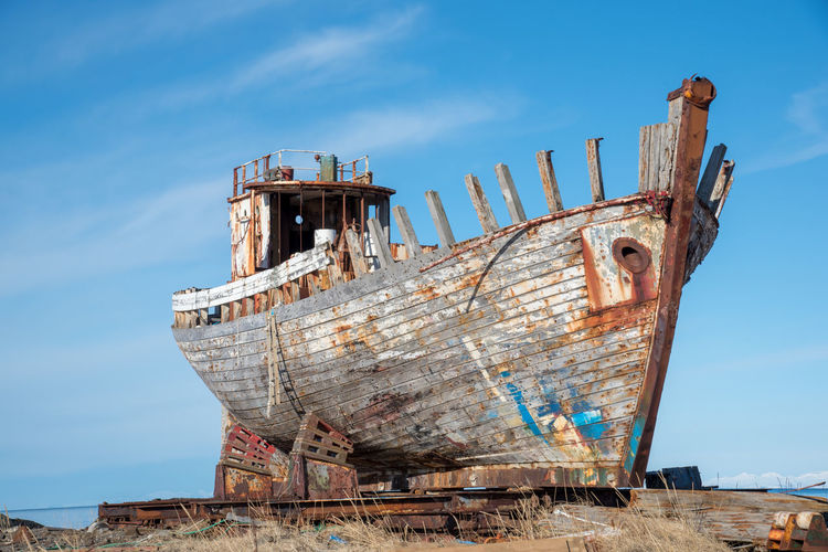 Old rusty ship against blue sky