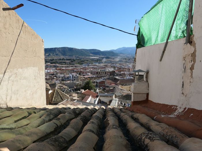 Roof top view in Mula, Spain EyeEm Selects Roof Tile Rooftop Roof Building Exterior Architecture Built Structure Building Sky City Nature Residential District Day Clear Sky Mountain Sunlight No People Outdoors House Wall Town Transportation Cable Mode Of Transportation My Best Photo