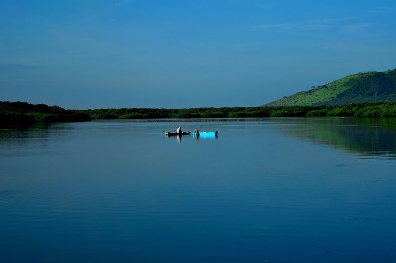 Reflection Blue Water Lake Nature Nautical Vessel Tree Sky Clear Sky Outdoors Tranquility People Tranquil Scene Scenics Adults Only Day Floating On Water Beauty In Nature Adult One Person Veracruz Mexico Landscape_Collection GetbetterwithAlex