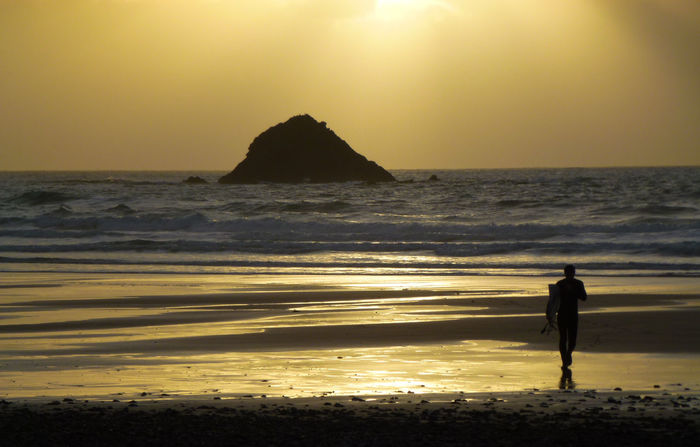 Surfer at sunset in britanny Sunset_collection Surf Surfer Beach Beauty In Nature Gold Coloured Horizon Over Water Men Nature One Person Outdoors Real People Sand Scenics Sea Shore Silhouette Sky Sunset Tranquil Scene Tranquility Water