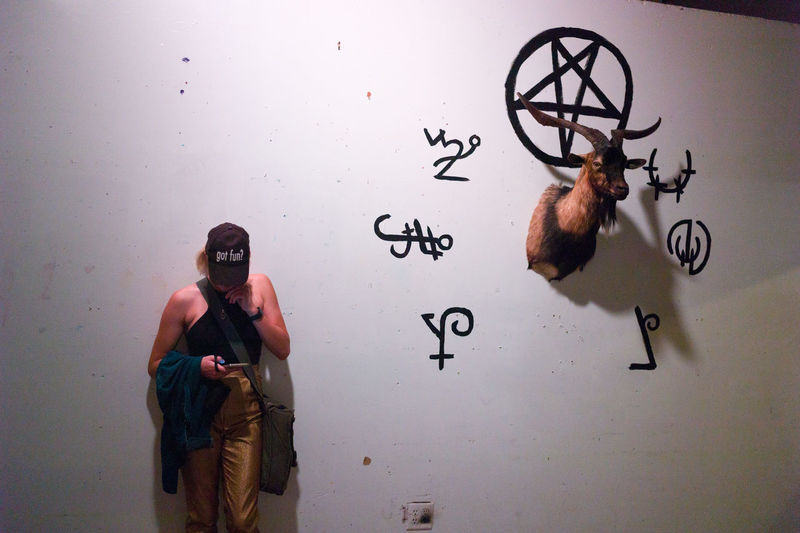 Art Casual Clothing Creativity Exploration Goat Head Hobbies Indoors  Mask - Disguise Memories Pentagram Standing Technology Three Quarter Length Wall - Building Feature Wiccan