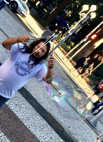 Soap Bubble Architecture Building Exterior Built Structure Casual Clothing City Day Front View Full Length Happiness Leisure Activity Lifestyles Motion One Person Outdoors People Real People Soap Ball Soap Bubble Soap Bubbles Street Tree Viciogame Young Adult
