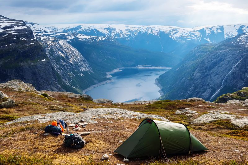 Hikers delight 👏 Lake EyeEm Selects Scenics - Nature Beauty In Nature Water Nature Tranquil Scene Tranquility Mountain Sky Tent Non-urban Scene Snowcapped Mountain Outdoors Adventure Idyllic High Angle View