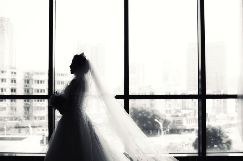 Wedding Dress Bride Wedding Window Real People Indoors  One Person Young Adult Women Day Young Women Life Events Bridal Shop Beautiful Woman One Young Woman Only Adult Adults Only People