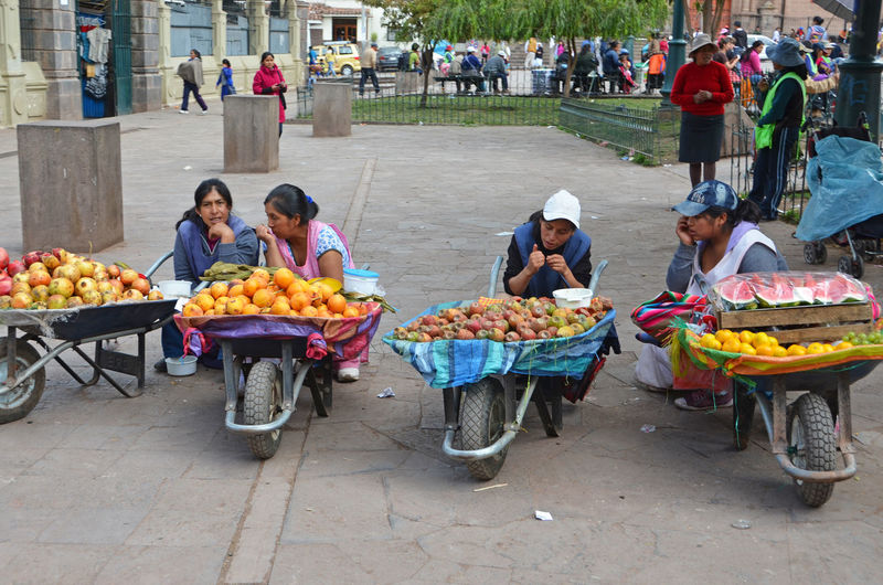 Waiting for customers Culture Food Fresh Fruits Indian Lifestyle Lifestyles Market Native Native American Indian Outlet Peruvian Sale Selling South America Street Telling Stories Differently Trade Traditional Up Close Street Photography Vegetables Woman The Shop Around The Corner Original Experiences People And Places