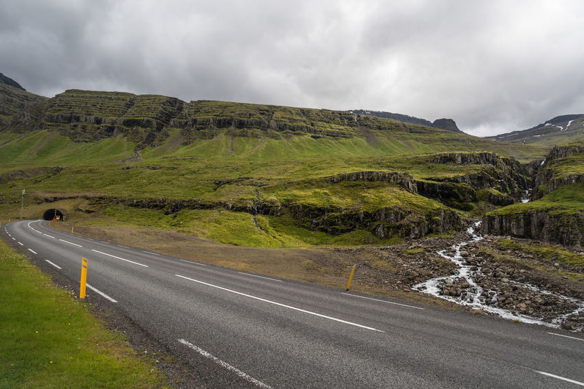 Beuatiful Nature Iceland Mountain View Mountian  Rock Stone Wall Atemberaubende Natur Beauty In Nature Cloud - Sky Clouds And Sky Day Direction Environment Grass Iceland 2018 Iceland Fire And Ice Island Island 2018 Island Insel Aus Feuer Und Eis Landscape Lava Island Lava Stone Meadow Moss Mountain Mountain And Clouds Mountain And Sky Nature No People Non-urban Scene Outdoors Road Rock Stones Scenics - Nature Sign Silent Moment Sky Street Symbol The Way Forward Tranquility Transportation Viking Island Water Waterfall Capture Tomorrow
