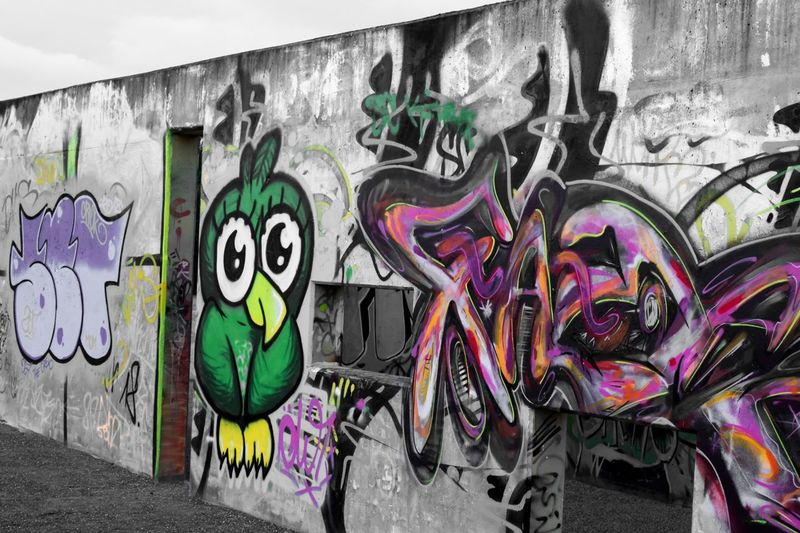 Graffiti Creativity Art And Craft Wall - Building Feature Street Art Multi Colored Architecture Wall Paint Built Structure No People Text Day Representation Communication Spray Paint Outdoors Surrounding Wall Human Representation Mural