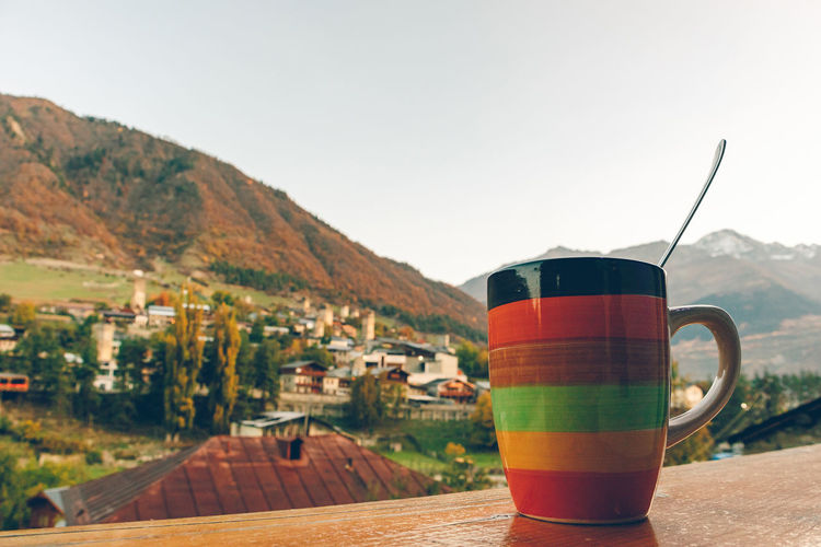Close-up of coffee on table against mountain