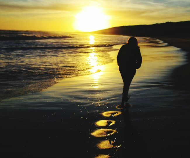 Into the Sun EyeEmNewHere Lifestyle Beachlife Adventure Water Sea Sunset Beach Silhouette Wave Reflection Sun Sunlight Sky FootPrint Tranquil Scene