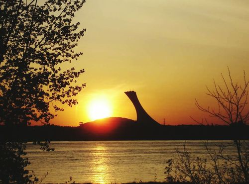 Sunset Silhouette Water Sun Tranquil Scene Orange Color Tranquility River Riverside Montreal, Canada Montreal Canada Olimpic Stadium Outdoors Sky Calm
