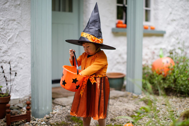Girl wearing halloween costume while standing outdoors