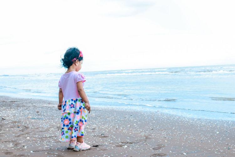 Little girl by the beach