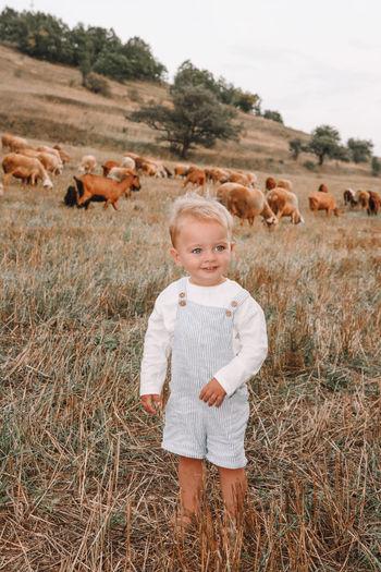 Portrait of boy standing in a field