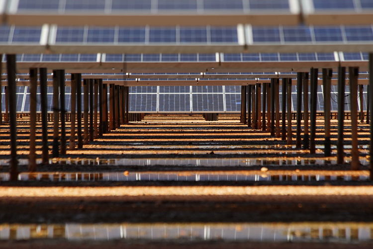 Low Angle Shot Low Angle View Shade Solar Panel Under Built Structure Close-up In A Row Installation Looking Through Metal No People Outdoors Photovoltaic Reflection Renewable Energy Rows Of Solar Panels Solar Energy Solar Farm Solar Panels Sunlight
