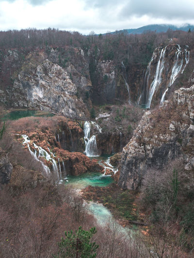 Nature park Plitvice lakes with large waterfalls in winter season Water Scenics - Nature Rock Beauty In Nature Flowing Water Rock - Object Plant Nature No People Flowing Outdoors Plitvice National Park Plitvice Lakes  Lake Waterfall Waterfalls Famous Place Travel Croatia Europe Season  Scenics Day Nobody Landscape View Top Flowing Water