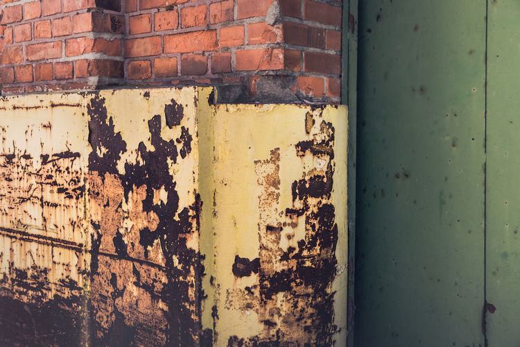 Abandoned Architecture Bad Condition Brick Brick Wall Building Exterior Built Structure Damaged Day Decline Deterioration Metal No People Old Outdoors Run-down Rusty Wall Wall - Building Feature Weathered