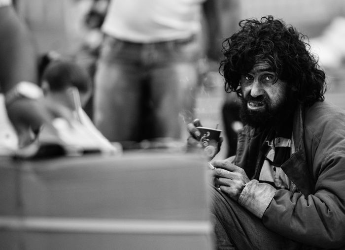 a man in the market Life Lifestyles Man People Person Poor  Sitting Travel