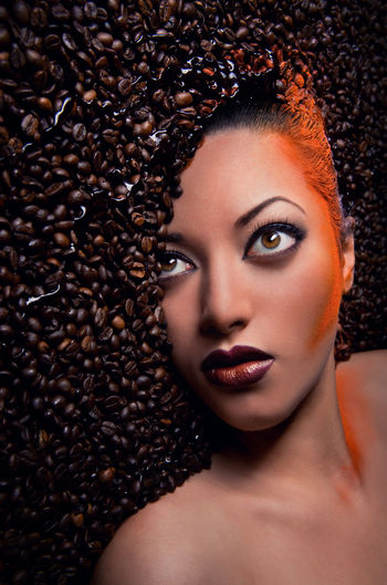 Gorgeous woman's face over coffee beans Chocolate Creativity Make-up Makeup Woman Aroma Backgrounds Beautiful People Beautiful Woman Beauty Brown Caucasian Close-up Coffe Beans Fashion Headshot Human Face One Person One Young Woman Only People Portrait Women Young Adult Young Woman Young Women