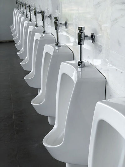 Close-Up Of Empty Urinals