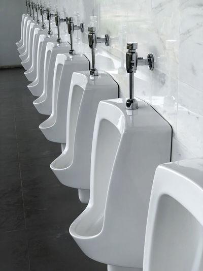 Close-up of empty urinals
