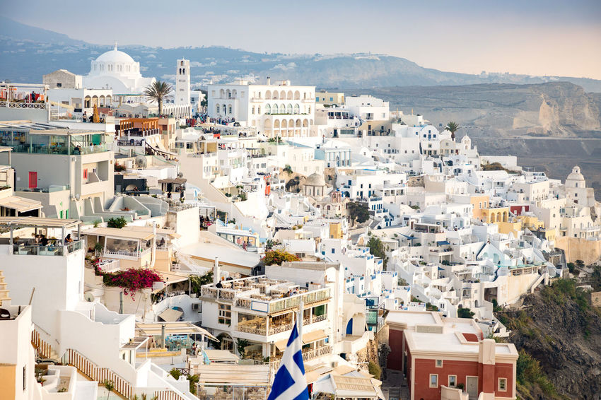 Greece Santorini Oia Thira Building Exterior Architecture Built Structure Building Residential District City Mountain Crowded Crowd Nature Day High Angle View Community Cityscape Town House Outdoors Sunlight Sky TOWNSCAPE Settlement