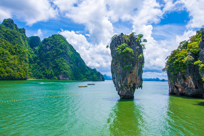 Beautiful beach landscape in Thailand Beautiful Cloud Phuket Thailand Travel Andaman Bay Beach Beauty In Nature Boat Cloud - Sky Day Dusk Green Color Landscape Mountain Nature Nautical Vessel No People Ocean Outdoors Relax Rock - Object Scenics Sea Sky Tranquil Scene Tranquility Water Waterfront