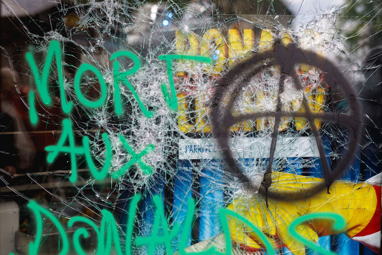 May Day No People Full Frame Multi Colored Close-up Backgrounds Graffiti Day Pattern Bicycle Transportation Wall - Building Feature Outdoors Wheel Motion Focus On Foreground Creativity Green Color Paint Tire Spoke Riot Protest Paris Window France