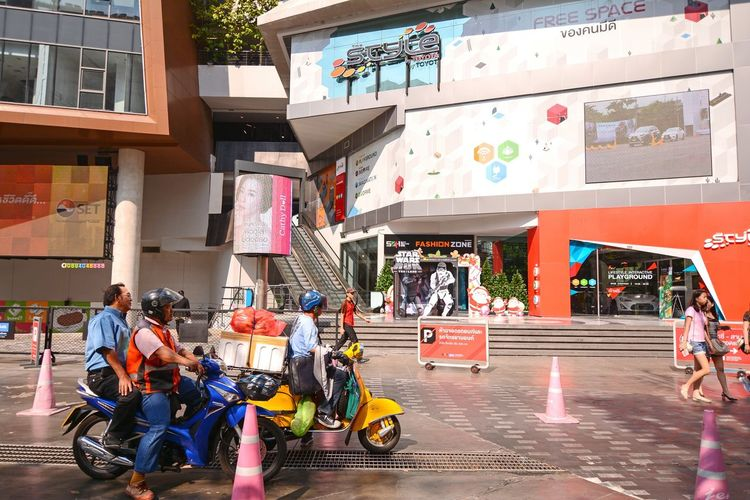 Bangkok, Siam Square, Thailand - January 4, 2016: The Style by Toyota, Hi-Tech Edutainment Center, education through entertainment, a new intelligent building right in the heart of Siam Square. City Day People Scooter Bangkok Thailand Commercial Centre  City Street Street Siam Square City Editorial  Edutainment Toyota Center Hitech Hi Tech Education Through Technology Entertainment Traffic ASIA Adapted To The City Miles Away Mobility In Mega Cities Stories From The City