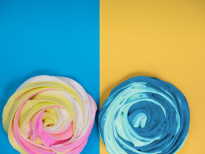 Blue Multi Colored Close-up Indoors  Colored Background No People Studio Shot Yellow Freshness Copy Space Food And Drink Food Variation Still Life Sweet Blue Background Indulgence Flower Sweet Food Pink Color Turquoise Colored Temptation