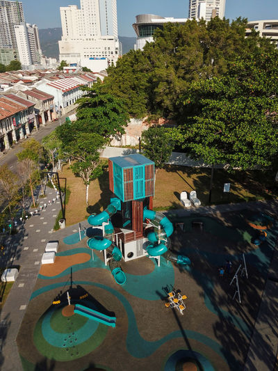 High angle view of swimming pool by buildings in city