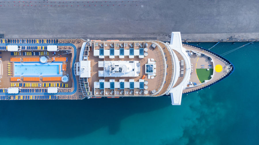 Aerial view of cruise ship moored at harbor