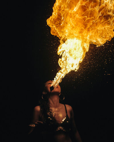 Woman playing with fire