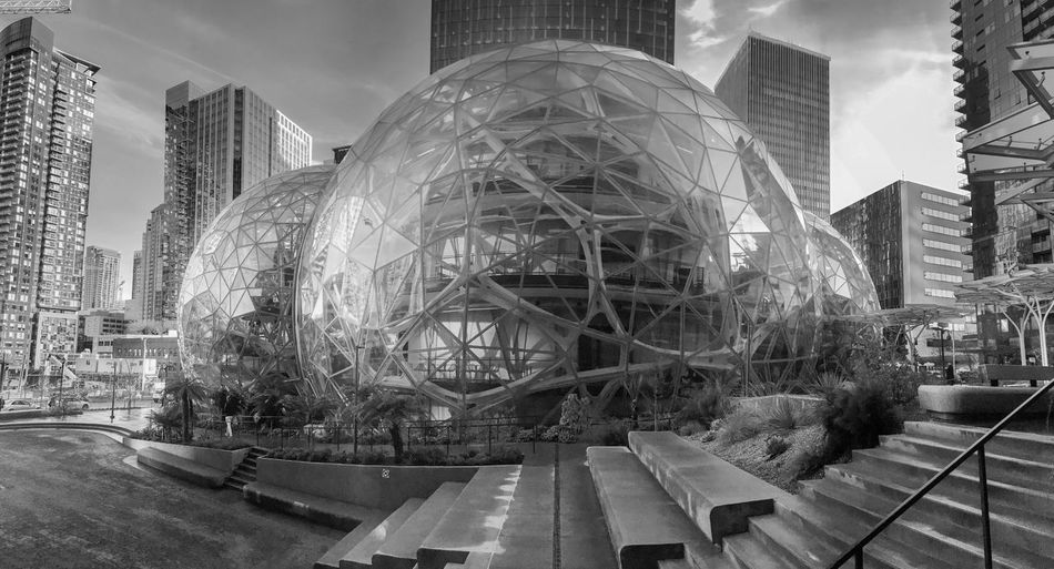 Amazon world headquarters spheres in downtown Seattle circa January 2018. Editorial featuring campus lawn, steps and surrounding towers. Architecture Business Campus Condominiums Downtown Jeff Bezos Offices Seattle Skyline Washington Amazon Black And White Design Engineering Finance Green Houses Headquarters Housing Lawn Office Towers Real Estate Software Spheres Wealth World