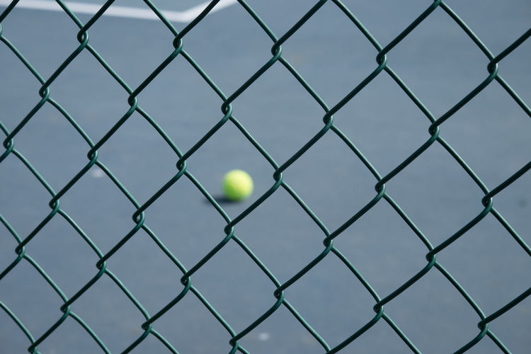 Ball seen through chainlink fence