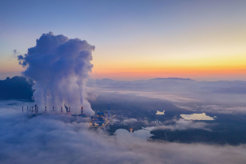 Aerial view of clouds over mountains during sunset coal power plant