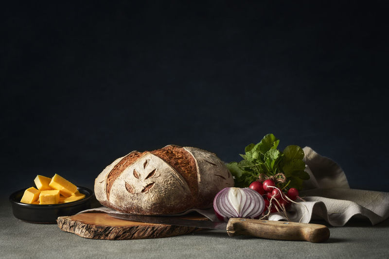 Beautiful sourdough bread with fresh vegetables and butter
