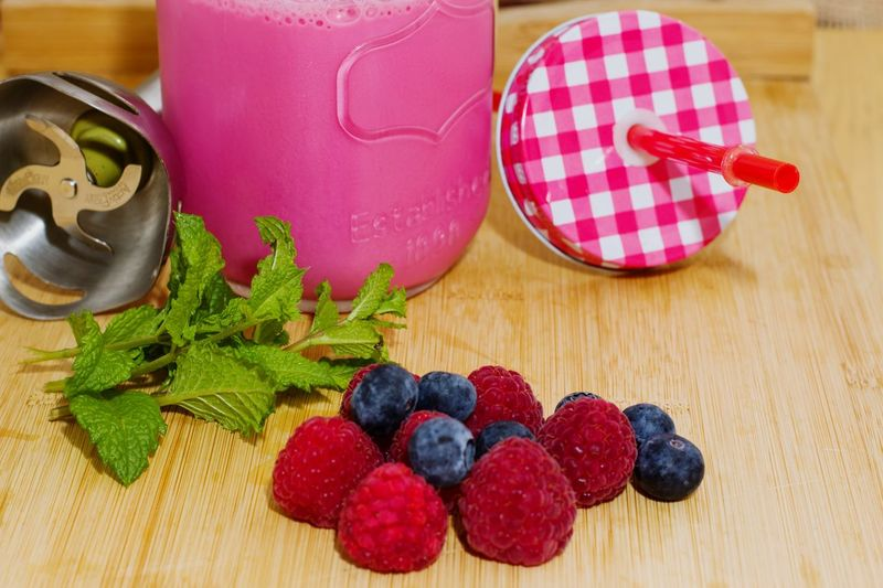Red Table Freshness Smoothies!♥ Smoothie Ready To Drink Milkshake♥ Milkshake Time Food And Drink Milkshake Photography Raspberry Blueberry Backgrounds