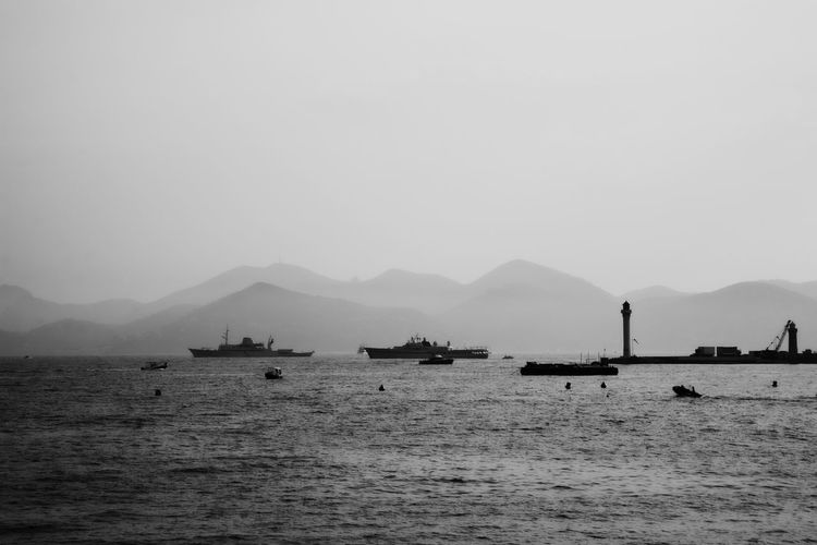 Bay skyline in Cannes at sunset Bay Beauty In Nature Black & White Black And White Blackandwhite Blackandwhite Photography Day Harbor Luxury Mode Of Transport Mountain Nature Nautical Vessel No People Outdoors Scenics Seaside Sky Skyline Tranquil Scene Tranquility Transportation Water Yacht Yachting