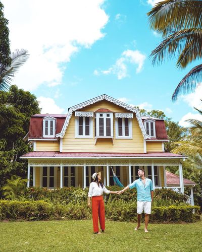 Saint Lucia St Lucia Men Caribbean Woman Beach Hat Dress House Wooden Old Souffiere Men Full Length Front Or Back Yard Tree Sky Architecture Building Exterior Country House Historic Abandoned Family Bonds Young Family Mansion Two Parents Wearing Outside Sundress Strapless