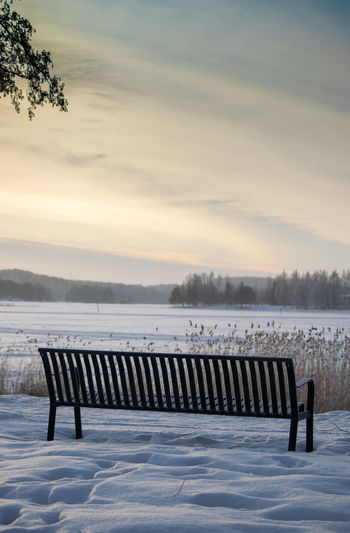 Beauty In Nature Bench Cold Temperature Day In A Row Nature No People Outdoors Penkki Scenics Sky Snow Sunset Tree Water Winter Miles Away Shades Of Winter