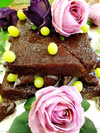 Chocolate moist cake with roses Cake Chocolate Cake On A Table Moist Grapes Flower Petal Freshness No People Indoors  Close-up Fragility Beauty In Nature Flower Head Food