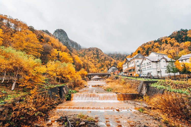 Daisetsuzan Architecture Built Structure Nature Plant Tree Autumn Sky Beauty In Nature Building Exterior Water Change Scenics - Nature No People Mountain Day Building Orange Color Outdoors Tranquility Fall Autumn Collection Flowing Water