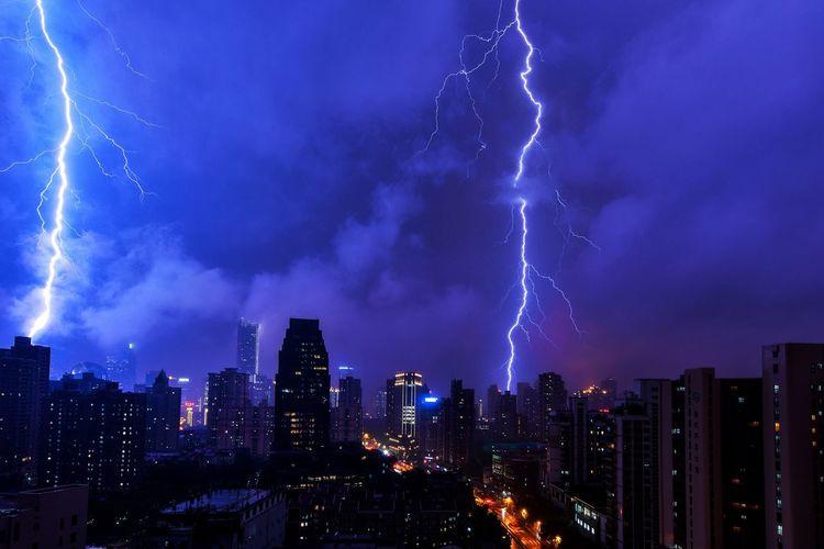 Lightning In Sky Above City At Night