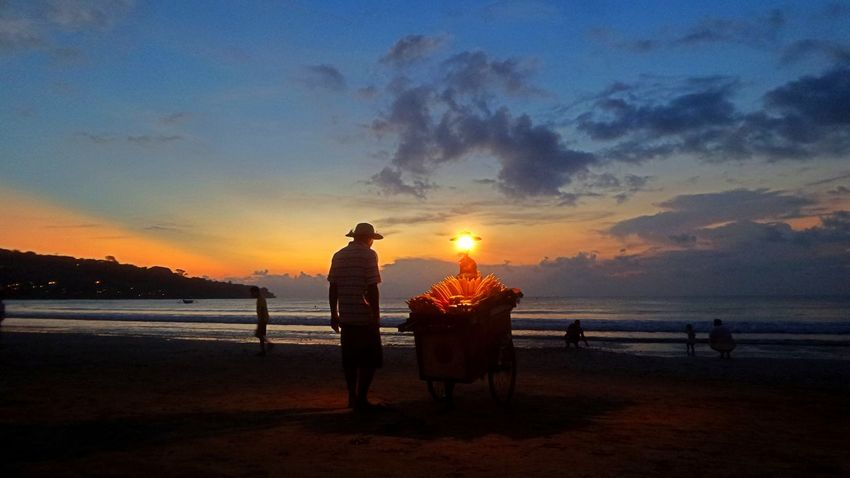 Sunset in Jimbaran. Alone Bali Beach Life Jimbaran Beach Beauty In Nature Cloud - Sky Corn Full Length Horizon Over Water Lamp Leisure Activity Men Nature Orange Color Outdoors Real People Scenics Sea Silhouette Sky Sun Sunset Tranquil Scene Water