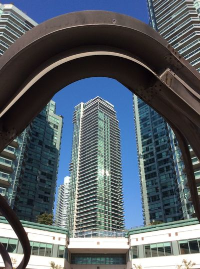 Canada Modern Architecture Modern Art Steel Iron Rusting High Rise Building Contemporary Art Arch blue sky September strong morning sun