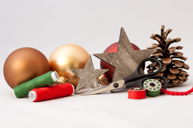 Tailor Studio Shot White Background Still Life Indoors  No People Red Close-up Holiday Christmas Choice Group Of Objects Christmas Decoration Decoration Cut Out Christmas Ornament Copy Space Merry Christmas! Scissors Thread Backgrounds Pine Cone Star Celebration Textile Industry