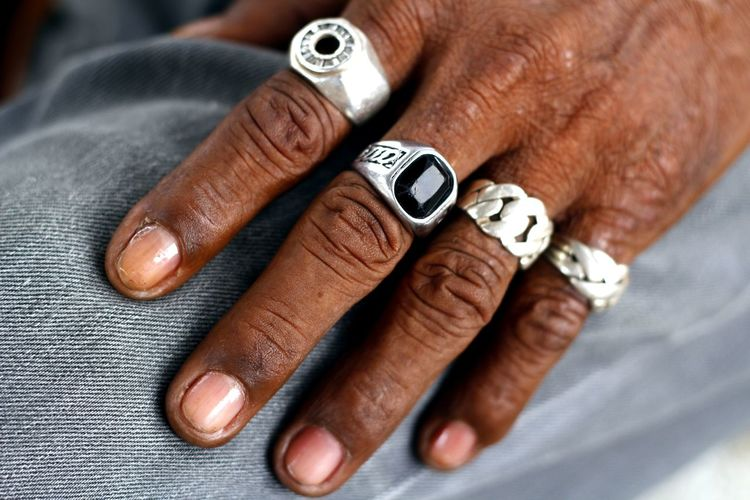 Cropped hand wearing rings