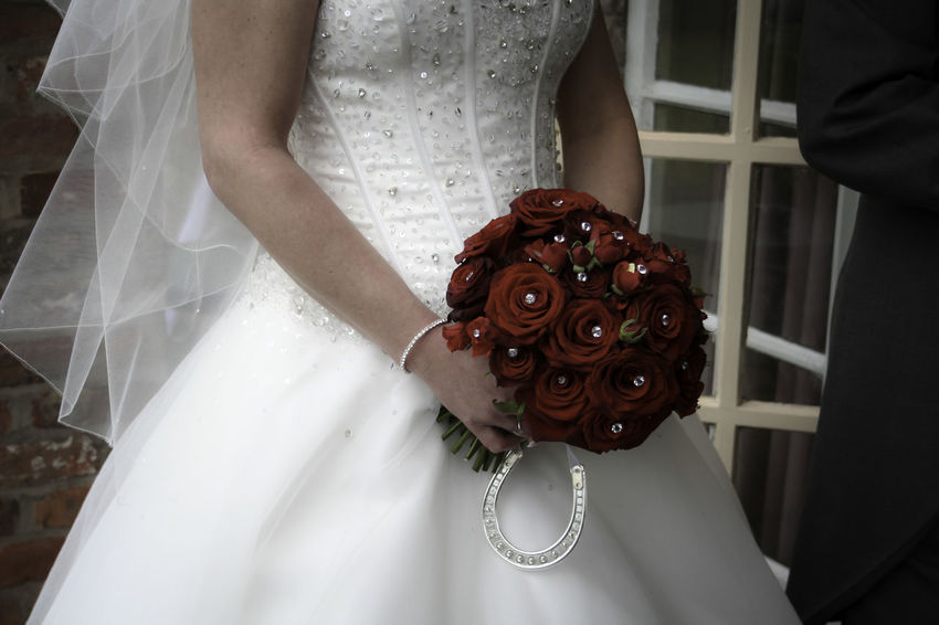 'Bride with diamonte flowers' Bouquet Bride Bridegroom Celebration Celebration Event Close-up Day Diamonte Flower Groom Holding Indoors  Life Events Lifestyles Midsection One Person People Real People Standing Wedding Wedding Ceremony Wedding Dress Well-dressed