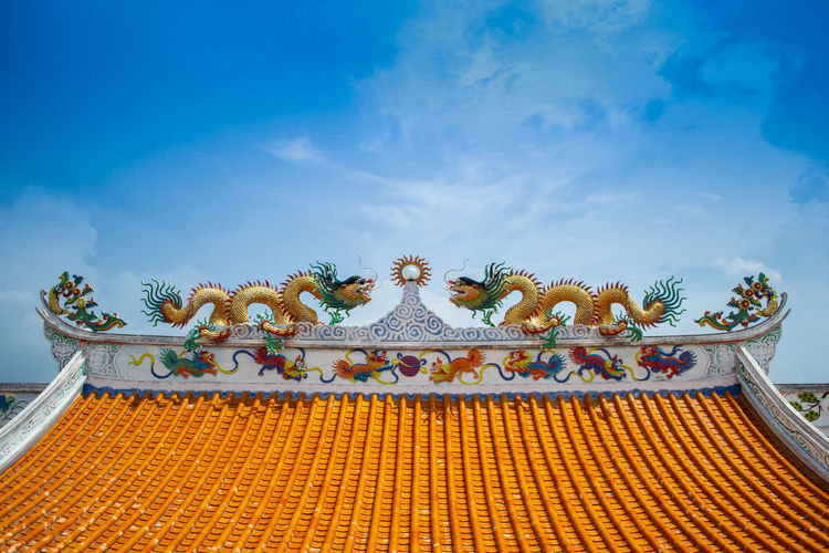 Low angle view of ornate roof against sky